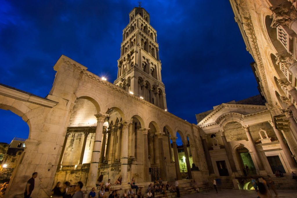 Diocletian's Palace's peristyle in front of Cathedral of Saint Domnius' bell tower in Split, Croatia at evening.